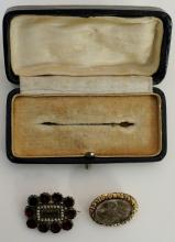 Two Victorian mourning brooches, one with vacant centre within seed pearl a