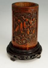 A 19th Century Chinese bamboo brush pot the front carved with three figures
