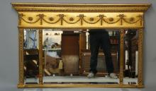 A reproduction gilt landscape over mantel mirror in Regency style, 82cm hig