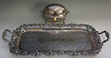 A plated two handled serving tray with cast border of bunches of grapes and