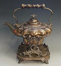 A William IV plated tea kettle on stand, the lobed body engraved to one sid