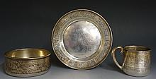 An interesting American silver Christening set comprising a mug, bowl and p