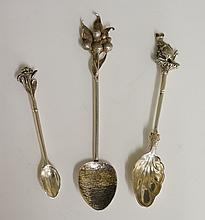 A selection of three silver souvenir? spoons, to include: a demi-tasse spoo