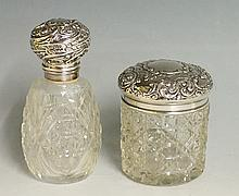A silver topped dressing table jar, the silver lid chased and embossed with