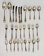 A part canteen of silver cutlery comprising: two serving spoons, seven teas