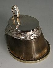 A Victorian silver mounted hoof ink well, the lid with scroll handle and en