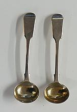 A pair of William IV fiddle pattern mustard spoons with gilded bowls, by Ma