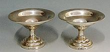 A pair of small silver dishes, the plain bowls with folded over rims, stepp