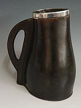A silver mounted brown leather jack, the sturdy body and handle with thick