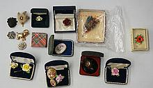 A selection of brooches, painted bone china flowers from brands such as Coa