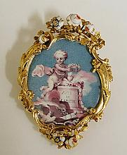 A fine 19th Century gold coloured metal mounted and enamel brooch of cartou