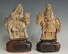 A pair of mottled green soapstone figures of warriors on horseback, fret pi