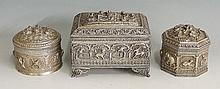 An Indian silver coloured metal casket of rectangular form the hinged lid e