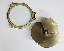 A bronze propeller inscribed SN1116 and HM221 RH004, 40cm diameter; a bronz