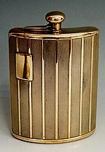 An engine turned ''radiator grille'' brass hip flask, the front with vacant