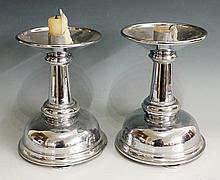 A pair of chromium plated altar candlesticks in late 17th Century style wit