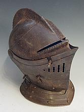 A reproduction iron helmet in Renaissance style, the hinged mobile visor wi