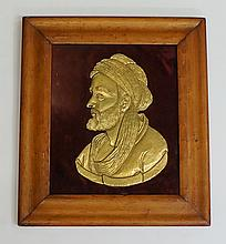 A 19th Century embossed gilt metal portrait plaque of a bearded gentleman,