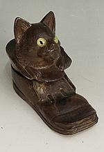 Black Forest - a cat in shoe inkwell, the hinged lid revealing a sprung whi