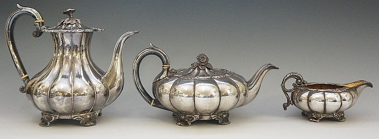A three piece Sheffield plate tea service comprising: tea pot, coffee pot a