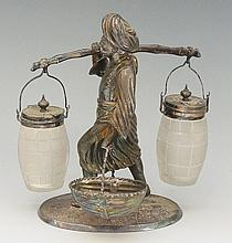 A Victorian novelty electro-plate cruet in the form of a traditionally garb
