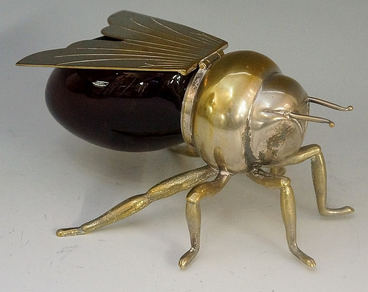 A silver plated honey pot in the form of a bee, the hinged wings acting as