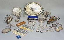 A quantity of silver plated ware to include: a large foliate engraved two h