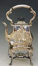 A silver plated bachelor's spirit kettle on stand, the body scrolling folia