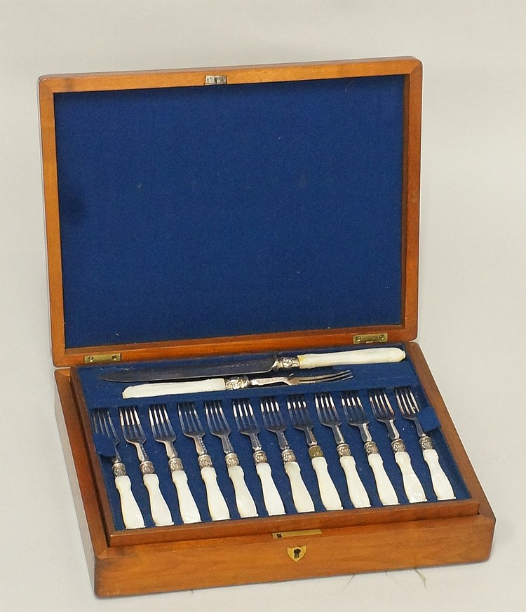 A cased set of fruits knives and forks with servers, comprising eighteen fr