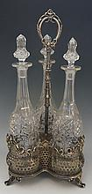 A Victorian silver plated trefoil decanter stand with three matching spirit