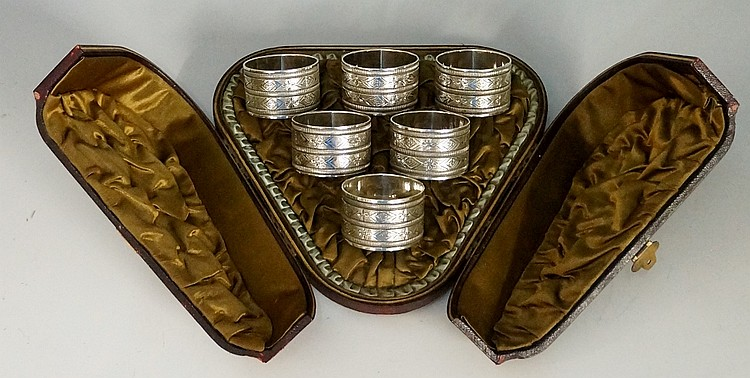 A set of six silver plated napkin rings, the bodies engraved with alternati
