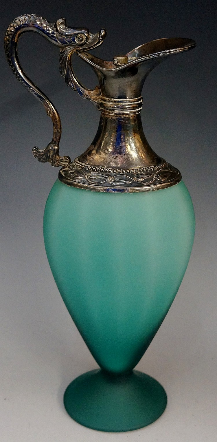 A moulded sea green frosted glass claret jug with white metal mounts, the h