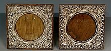 A pair of Edwardian square silver mounted photo frames, the silver fronts c