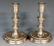 A pair of silver candlesticks, each with reeded knopped stems and stepped c