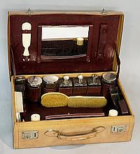 A French trousse d'voyage or vanity case, the fitted interior with seven si