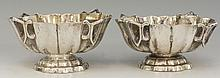 A pair of Russian silver coloured metal caviar dishes with fluted sides and
