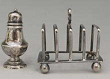 A miniature silver toast rack of simple angular form with plain ball feet,