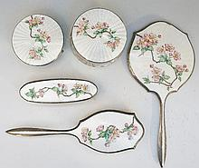 A silver dressing table set, each piece with very pale green enamel above e