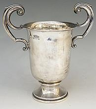 A silver trophy cup with two S scroll handles, plain body, circular pedesta
