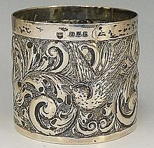 A Victorian silver bottle coaster, the body chased and engraved with the pe
