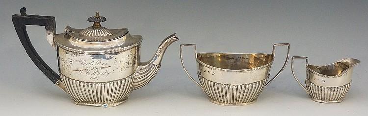 A Victorian three piece silver tea service comprising: teapot, cream jug an