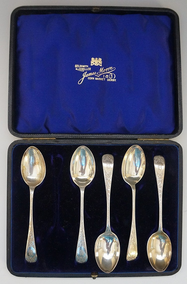 A Victorian cased set of five teaspoons, the handles foliate engraved and e