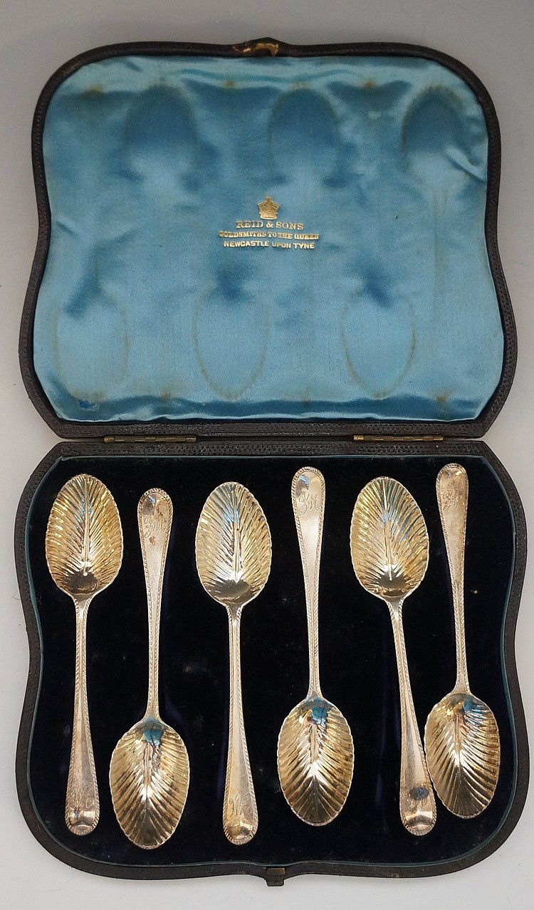 A Victorian cased set of six teaspoons with stylised leaf bowls, each engra