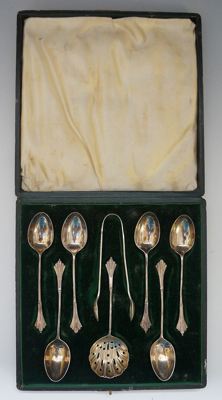A cased set of six teaspoons, tongs and a sugar sifter, all in a matching p