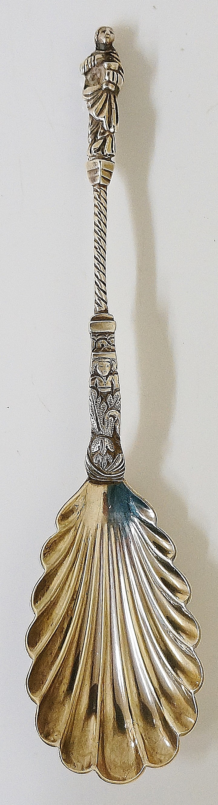 A Victorian silver apostle spoon of St John holding the cup of sorrow above