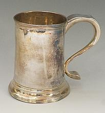 A good silver George III tankard with S-scroll handle and reeded rims, the