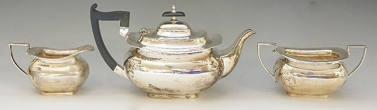A silver tea set comprising: teapot, cream jug and sucrier, plain boat shap