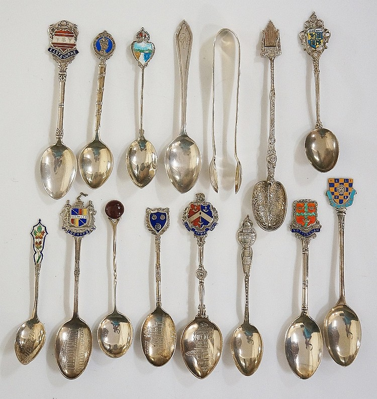 A quantity of silver souvenir spoons, mostly with enamelled crests to handl