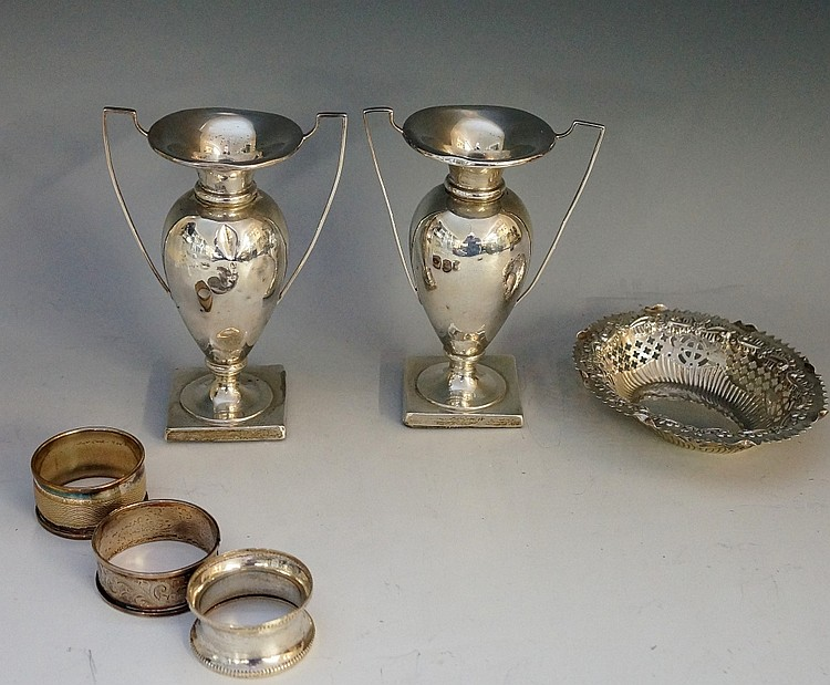 A selection of silver items to include: a pair of two handled urnular vases