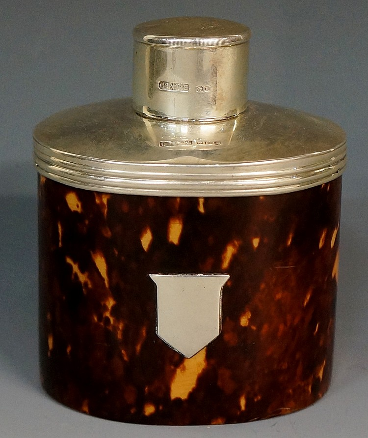 A tortoiseshell tea caddy, the oval body with vacant shield shaped cartouch